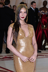 Olivia Munn walking the red carpet at The Metropolitan Museum of Art Costume Institute Benefit celebrating the opening of Heavenly Bodies : Fashion and the Catholic Imagination held at The Metropolitan Museum of Art  in New York, NY, on May 7, 2018. (Photo by Anthony Behar/Sipa USA)