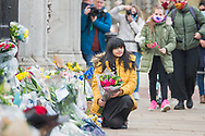 A young girl from the public lays yellow flowers In memory of Prince Philip The Royal Highness the Duke of Edinburgh, London on 9 April 2021.