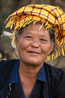 INLE LAKE, MYANMAR - CIRCA DECEMBER 2013: Burmese woman smiling in the Taung Tho Market in Inle Lake, Myanmar