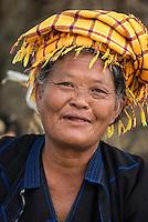 INLE LAKE, MYANMAR - CIRCA DECEMBER 2013: Burmese woman smiling in the Taung Tho Market in Inle Lake, Myanmar