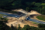 Nederland, Gelderland, Gemeente Apeldoorn,  30-06-2011. Veluwe, Rijksweg A1, aanleg ecoduct Hoog Buurlo.New construction ecoduct (wildlife bridge crossing highway) over the A1 highway..luchtfoto (toeslag), aerial photo (additional fee required).copyright foto/photo Siebe Swart