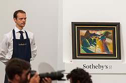 © Licensed to London News Pictures. 19/06/2018. LONDON, UK. ''Gabriele Münter Im Freien Vor Der Staffelei  (Gabriele Münter Painting Outdoors In Front Of An Easel)'' by Wassily Kandinsky, (Est. £3,000,000 - 5,000,000) sold for a hammer price of £4,500,000 at Sotheby's Impressionist & Modern art evening sale in New Bond Street.  Photo credit: Stephen Chung/LNP