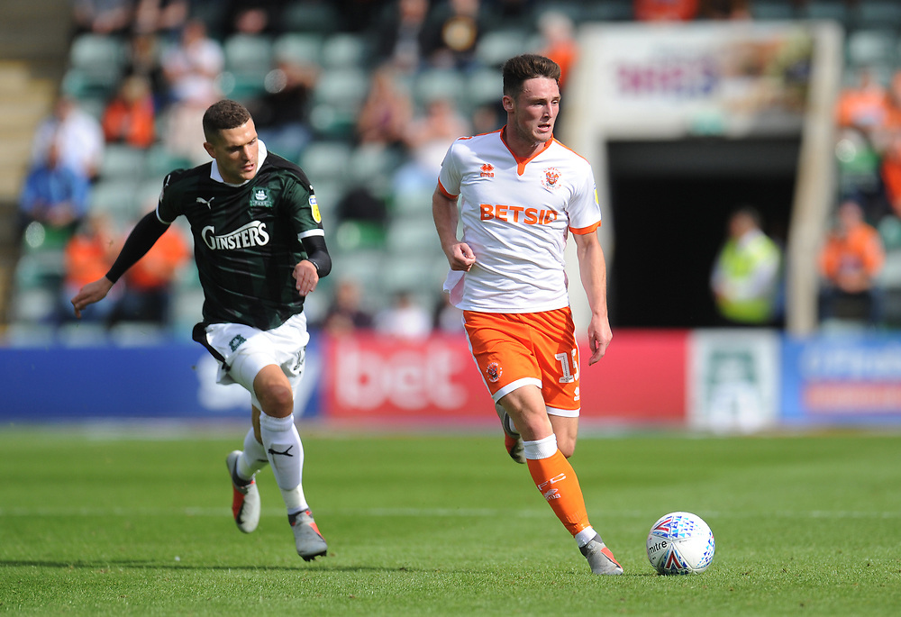 Blackpool's Jordan Thompson under pressure from Plymouth Argyle's Stuart O'Keefe<br /> <br /> Photographer Kevin Barnes/CameraSport<br /> <br /> The EFL Sky Bet League One - Plymouth Argyle v Blackpool - Saturday 15th September 2018 - Home Park - Plymouth<br /> <br /> World Copyright © 2018 CameraSport. All rights reserved. 43 Linden Ave. Countesthorpe. Leicester. England. LE8 5PG - Tel: +44 (0) 116 277 4147 - admin@camerasport.com - www.camerasport.com