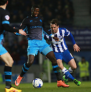 Sheffield Wednesday striker Lucas Joao shields the ball from Brighton central midfielder Dale Stephens during the Sky Bet Championship match between Brighton and Hove Albion and Sheffield Wednesday at the American Express Community Stadium, Brighton and Hove, England on 8 March 2016. Photo by Bennett Dean.
