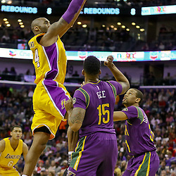 Feb 4, 2016; New Orleans, LA, USA; Los Angeles Lakers forward Kobe Bryant (24) shoots over New Orleans Pelicans forward Alonzo Gee (15) and New Orleans Pelicans guard Bryce Dejean-Jones (31) during the first quarter of a game at the Smoothie King Center. Mandatory Credit: Derick E. Hingle-USA TODAY Sports