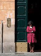 Woman in doorway, Rome, Italy.