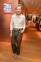 HENRY CONWAY at a party to celebrate the launch of Le Jardin de Monsieur Li by Hermes in association with Mr Fogg's was held at Hermes, 155 New Bond Street, London on 9th July 2015.