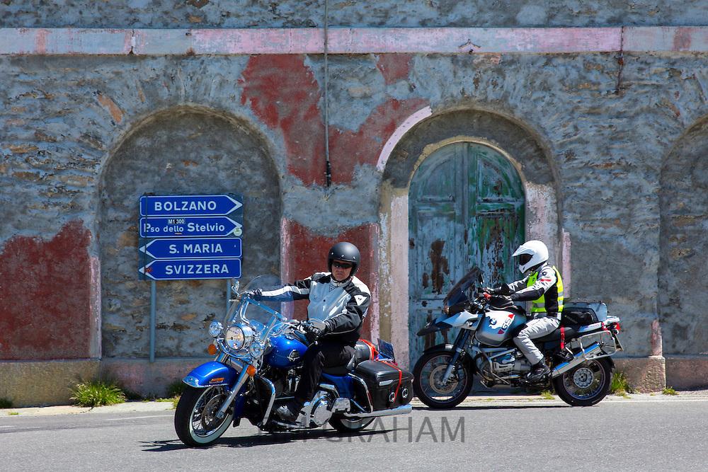 Harley Davidson Road King motorbike and BMW  R1150GS on The Stelvio Pass, Passo dello Stelvio, Stilfser Joch, to Bormio, Italy