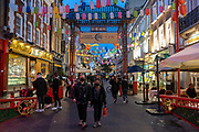 As Prime Minister Boris Johnson announces a second Coronavirus nationwide lockdown during the second wave of the pandemic, business carries on as usual on Gerrard Street in London's Chinatown, on 31st October 2020, in London, England. Small business such as these restaurants will again have to close except for takeaways from Thursday, and for a period of one month.