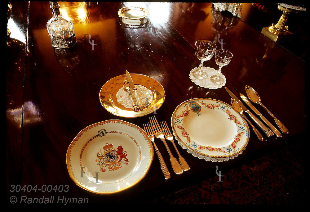 Armorial place setting in Dining Room includes dish (left) picturing Bowes Lyon arms; Glamis Castle, Scotland.