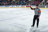 KELOWNA, CANADA - MARCH 3: Referee Mike Campbell stands on the ice at the Kelowna Rockets against the Portland Winterhawks  on March 3, 2019 at Prospera Place in Kelowna, British Columbia, Canada.  (Photo by Marissa Baecker/Shoot the Breeze)