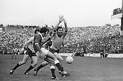 Dublin player holds his hands up to block Galway's kick towards the goal during <br />