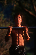 A young Nepali boy is undergoes a recruitment test of pull-ups for the Gurkha Regiment, part of a tough endurance series to find physically perfect specimens for British army infantry training, on 16th January 1997, in Pokhara, Nepal. 60,000 boys aged between 17-22 (or 25 for those educated enough to become clerks or communications specialists) report to designated recruiting stations in the hills each November, most living from altitudes ranging from 4,000-12,000 feet. After initial selection, 7,000 are accepted for further tests from which 700 are sent down here to Pokhara in the shadow of the Himalayas. Only 160 of the best boys succeed in the journey to the UK. Nepal has been supplying youths for the British army since the Indian Mutiny of 1857. (Photo by Richard Baker / In Pictures via Getty Images)