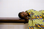 A girl lies on a bench at the NDA health center in Dimbokro, Cote d'Ivoire on Friday June 19, 2009.