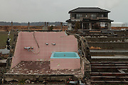 Tsunami damaged houses inside the Fukushima exclusion zone, Namie, Fukushima, Japan. Wednesday March 9th 2016. The Great East Japan Earthquake on March 11th 2011 was followed by a massive tsunami that levelled much of the Tohoku coast in north east Japan, killing around 18,000 people and causing meltdowns and explosions at the Fukushima Daiichi nuclear power station leading to the contamination and evacuation of a 20 kilometre exclusion zone around the plant.