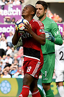 Football - 2017 / 2018 Premier League - Swansea City vs. Watford<br /> <br /> André Carrillo of Watford holds the ball after missing an opportunity , at the Liberty Stadium.<br /> <br /> COLORSPORT/WINSTON BYNORTH