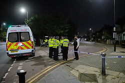 © Licensed to London News Pictures. 13/11/2020. London, UK. Police officers stand next to a van at a cordon on Northwick Avenue. Police were called at 15:50GMT to Northwick Park, Harrow, following reports of a stabbing. Metropolitan Police Service attended and found a male, believed to be aged 17, suffering stab injuries. He was given first aid at the scene by officers prior to the arrival of London Ambulance Service. Despite the efforts of emergency services, he was pronounced dead at 16:31GMT. Photo credit: Peter Manning/LNP