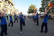 Supporters run past 'The Pack'  outside Twickenham before k/o. Rugby World Cup 2015 pool D match, France v Italy at Twickenham Stadium in London on Saturday 19th September 2015.<br /> pic by John Patrick Fletcher, Andrew Orchard sports photography.