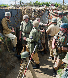 Reenactors portraying German paratroopers (Fallschirmjäger) 1 fallschirmjäger Division, 3 fallschirmjäger Regiment, Gothic line Italy wearing tropical kit at the Yorkshire War Experience <br />  04 July 2015<br />  Image © Paul David Drabble <br />  www.pauldaviddrabble.co.uk