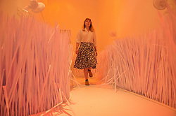 © London News Pictures. 23/06/15. London, UK. Bethany Bull walks through the installation 'Artificial Paradise' by Riah Naief which is part of the Royal College of Art Graduate Exhibition 2015, Central London. Photo credit: Laura Lean/LNP
