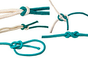 Assortment of various nautical knots on white background