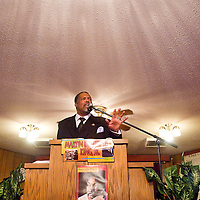 012113       Brian Leddy<br /> Reverend Calvin Robinson gives an emotional speech during a Dr. Martin Luther King Jr. celebration at St. Paul's Missionary Baptist Church Monday afternoon. The annual event drew community members from a variety of backgrounds.