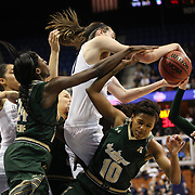 Breanna Stewart, UConn, rebounds as Courtney Williams, USF, is bundled to the floor during the UConn Huskies Vs USF Bulls Basketball Final game at the American Athletic Conference Women's College Basketball Championships 2015 at Mohegan Sun Arena, Uncasville, Connecticut, USA. 9th March 2015. Photo Tim Clayton