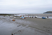 Boats moored on the sands at Parrog on 17th August 2021 in Pembrokeshire, Wales, United Kingdom. Newport is a town, parish, community, electoral ward and ancient port of Parrog, on the Pembrokeshire coast in West Wales at the mouth of the River Nevern in the Pembrokeshire Coast National Park.