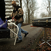 Illegal immigrants from Sierra Leone move houses in Amsterdam's Bijlmer area. They have to change their locations constantly to avoid police detection and seek better landlords. .Picture taken 2002 by Justin Jin. ..