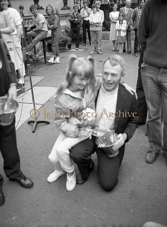 """Fr Niall O'Brien Returns from Captivity.1984..14.07.1984..07.14.1984..On 6 May 1983,Fr Niall O'Brien was arrested along with two other priests, Fr. Brian Gore, an Australian, Fr. Vicente Dangan, a Filipino and six lay workers - the so-called """"Negros Nine"""", for the murders of Mayor Pablo Sola of Kabankalan and four companions. The priests where held under house arrest for eight months but """"escaped"""" to prison in Bacolod City, the provincial capital, where they felt they would be safer.The case received widespread publicity in Ireland and Australia, the home of one of the co-accused priests, Fr. Brian Gore. When Ronald Reagan visited Ireland in 1984, he was asked on Irish TV how he could help the missionary priest's situation. A phone call the next day from the Reagan administration to Ferdinand Marcos resulted in Marcos offering a pardon to Fr. O'Brien and his co-accused..(Ref Wikipedia)...Fr O'Brien is pictured with a young girl at the Mansion House in Dublin."""