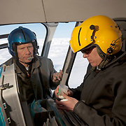 Dr. Steve Amstrup, lead biologist for the USGS polar bear capture project, instructing a co-worker on the fine points of shooting a dart gun at a running polar bear from a moving helicopter. Kaktovik, Alaska