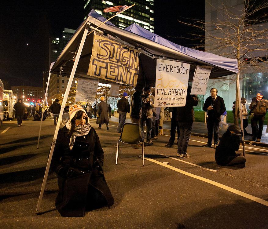 Boston, MA 12/09/2011.Occupy Boston protestors guard a tent in the middle of Atlantic Avenue early Friday morning..Alex Jones / www.alexjonesphoto.com