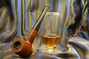 still life, Old wooden pipe and a glass of single malt highlands scotch whiskey on fabric background