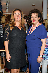 Left to right, PAULA MANSOUR and BARIA ALAMUDDIN (Amal Clooney's mother) at a party to celebrate the paperback lauch of The Stylist by Rosie Nixon hosted by Donna Ida at her store at 106 Draycott Avenue, London on 17th August 2016.