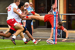 Brynmor Bradley of Wales scores his sides first try<br /> <br /> Photographer Craig Thomas/Replay Images<br /> <br /> Under 16 Rugby league International - Wales  v England  - Saturday 1st August 2018 - Stebonheath Park - Llanelli<br /> <br /> World Copyright © 2017 Replay Images. All rights reserved. info@replayimages.co.uk - www.replayimages.co.uk