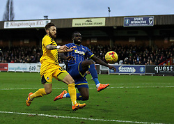 Matt Taylor of Bristol Rovers is tackled by Karleigh Osborne of AFC Wimbledon - Mandatory byline: Robbie Stephenson/JMP - 07966 386802 - 26/12/2015 - FOOTBALL - Kingsmeadow Stadium - Wimbledon, England - AFC Wimbledon v Bristol Rovers - Sky Bet League Two