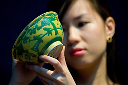 © London News Pictures. 04/11/2011. London, UK. One of two yellow and green glazed 'Boys' bowls (1723-1735) estimated to fetch up to £120,000 at a Christie's auction of Fine Chinese Ceramics and Works of Art on November 8th 2011. The auction, which is led by seven private collections, is expected to realise in excess of £15 million. Photo Credit : Ben Cawthra/LNP