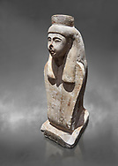 Ancient Egyptian statue of the goddess Meretseger, limestone, New Kingdom, 19-20th Dynasty, (1480-1390 BC), deir el Medina. Egyptian Museum, Turin. Grey background. Cat 957. .<br /> <br /> If you prefer to buy from our ALAMY PHOTO LIBRARY  Collection visit : https://www.alamy.com/portfolio/paul-williams-funkystock/ancient-egyptian-art-artefacts.html  . Type -   Turin   - into the LOWER SEARCH WITHIN GALLERY box. Refine search by adding background colour, subject etc<br /> <br /> Visit our ANCIENT WORLD PHOTO COLLECTIONS for more photos to download or buy as wall art prints https://funkystock.photoshelter.com/gallery-collection/Ancient-World-Art-Antiquities-Historic-Sites-Pictures-Images-of/C00006u26yqSkDOM