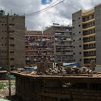 Housing blocks in the Pipeline district of Nairobi where Lilian Mutheu lives.<br /> <br /> Lilian Mutheu is a mentor in the Dreams project in Nairobi, Kenya.<br /> <br /> DREAMS is an acronym for Determined, Resilient, Empowered, AIDS-free, Mentored, and Safe women. The project aims to empower girls and young women between 10 and 24 years around issues including HIV prevention, contraceptive methods, health, education and social economic intervention.<br /> <br /> Lilian, who is mother, is familiar with some of the issues through her own personal experience and provides guidance and support to hundreds of young women and girls in the extensive slum of Makuru Kwa Njenga.