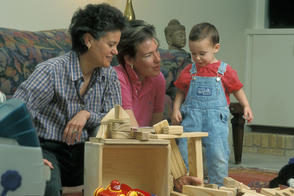 Anglo female life partners playing with biological 19 month old son in living room.  Model Release.<br /> <br /> ©Bob Daemmrich