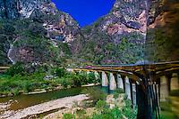 The CHEPE (Chihuahua al Pacifico Railroad) train passes over the Santa Barbara Bridge, near Temoris, Copper Canyon, Mexico