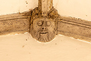 Carved wooden figure of a face in Metfield church porch, Suffolk, England, UK
