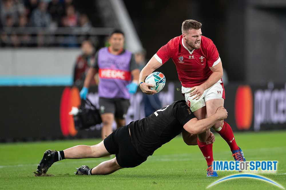 Owen Lane of Wales is tackled by Dane Coles of New Zealand during the Rugby World Cup bronze final match between New Zealand and Wales Friday, Nov, 1, 2019, in Tokyo. New Zealand defeated Wales 40-17.  (Flor Tan Jun/Espa-Images-Image of Sport)