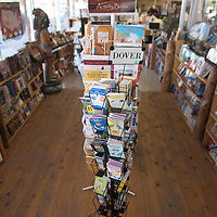 A rack of activity books sits in the middle of the book nook at Bulters in Gallup Tuesday.