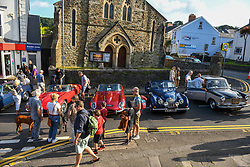 © Licensed to London News Pictures. 27/08/2021. Swansea, UK. The seaside village of Mumbles in Swansea, as it is taken over by vintage cars. The event saw the main street closed to traffic and full of historic vehicles and replicas, ranging from E-Type Jaguars, to modern day classics Photo credit: Robert Melen/LNP