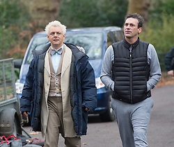 Emmy award-winning actor Jon Hamm as Archangel Gabriel filming a scene from Neil Gaiman &  Terry Pratchett's adaptation of Good Omens in Battersea Park, London, Great Britain <br />4th December 2017 <br /><br />Jon Hamm is best known for playing advertising executive Don Draper in the TV drama series, Mad Men<br /><br /><br />Seen here with Michael Sheen who plays the character Aziraphale about to rehearse their scene together <br /><br />Photograph by Elliott Franks <br /><br />Photograph by Elliott Franks <br />Image licensed to Elliott Franks Photography Services