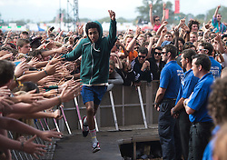 © London News Pictures. 25/08/2012. Reading, UK. Taco from Odd Future touching members of the crowd as Odd Future perform on the main stage on day two of Reading Festival 2012 in Reading, Berkshire, UK on August 25, 2012. The three day event which attracts over 80,000 music fans headlines The Cure, Kasabian and The Foo Fighters Photo credit : Ben Cawthra/LNP
