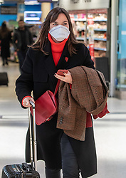 © Licensed to London News Pictures. 16/03/2020. London, UK. A London commuter on her way to work in a mask at a quiet Victoria Station this morning as Government ministers warn that over 70s will face self-isolation for weeks as the Coronavirus disease pandemic continues . Photo credit: Alex Lentati/LNP