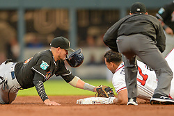 May 18, 2018 - Atlanta, GA, U.S. - ATLANTA, GA Ð MAY 18:  Braves infielder Johan Camargo (17) slides into second base while Marlins shortstop Miguel Rojas (19) applies the tag during the game between Atlanta and Miami on May 18th, 2018 at SunTrust Park in Atlanta, GA. Camargo was called out on instant replay review. (Photo by Rich von Biberstein/Icon Sportswire) (Credit Image: © Rich Von Biberstein/Icon SMI via ZUMA Press)