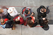 young adult people waiting in line seen from above
